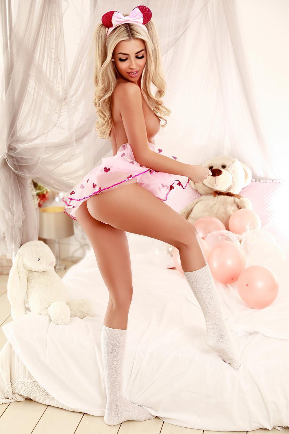 Roleplay London escort Ada in a pink dress