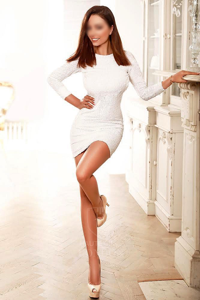 Elegant London escort Beate in white dress