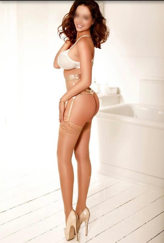 Friendly brunette escort Beate in London