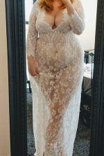 Standing in front of a mirror wearing a see through white lace dress - Amelia Swann - East London