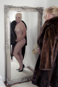 Elizabeth Hunter - Mink coat and nothing else.  Elizabeth Hunter